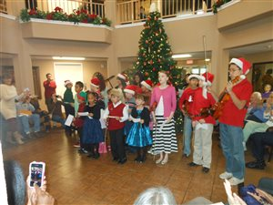 Singing We Wish You a Merry Christmas to the residents of Camden Springs Assisted Living